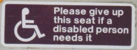 Disabled seating sign on a UK bus